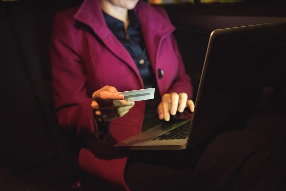 Woman completing online purchase