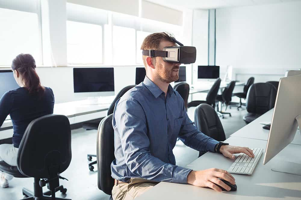 Man working with Virtual Reality headset